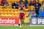 James Scott (#35) of Motherwell FC hides his face in his jersey at the final whistle, as Motherwell lose 2-0 in the Ladbrokes Scottish Premiership match between St Johnstone and Motherwell at McDiarmid Stadium, Perth, Scotland on 11 May 2019.