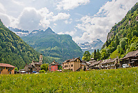 The beautiful village of Sonogno, Valle Verzasca, Ticino, Switzerland with the imposing mountains as backdrop.