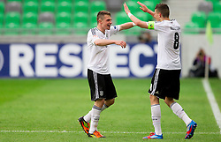 Pascal Itter of Germany and Leon Goretzka of Germany celebrate after  the UEFA European Under-17 Championship Semifinal match between Germany and Poland on May 13, 2012 in SRC Stozice, Ljubljana, Slovenia. Germany defeated Poland 1-0 and qualified to finals. (Photo by Vid Ponikvar / Sportida.com)