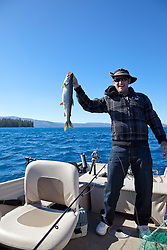 """Mackinaw Fishing on Lake Tahoe 1"" - This man, who caught a Mackinaw fish, was photographed near the West shore of Lake Tahoe, California."