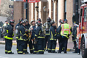 Firefighters gather on Exeter Street in Boston on April 15, 2013. Three people were killed by two explosions on Boylston Street near the finish line of the Boston Marathon, in which 27,000 people competed.
