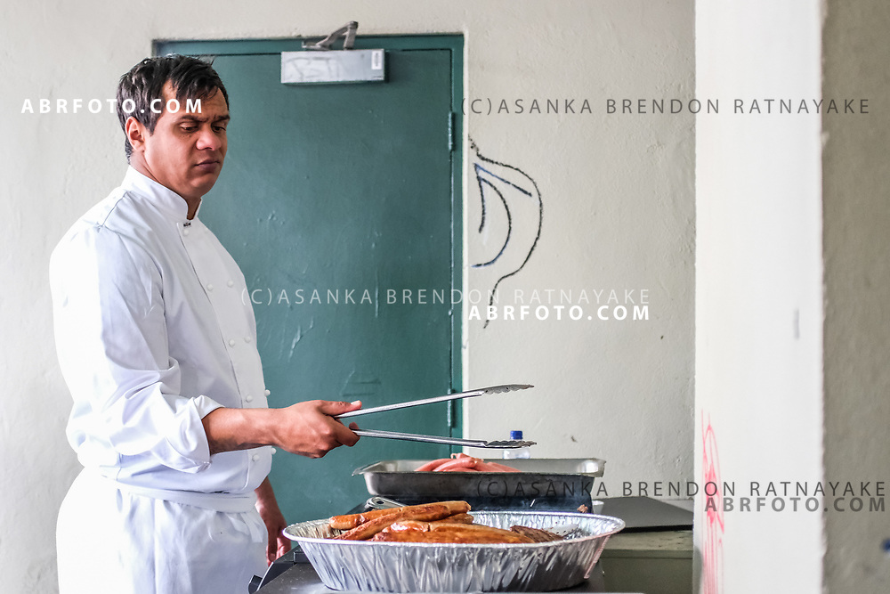 Trainee chef Matthew Williams cooks sausages at the front of the Aboriginal Youth Sport and Recreation centre on Gertrude Street on Melbourne, Australia, September 1, 2017. Matthew Williams is studying a certificate two in Hospitality. Asanka Brendon Ratnayake for the New York Times