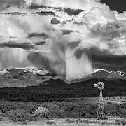 Massive storm clouds and virga hang over the Sangre de Cristo Mountains north of Santa Fe, New Mexico.