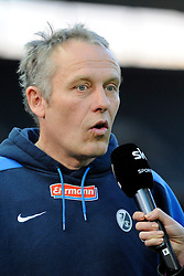 10.04.2012, Olympiastadion, Berlin, GER, 1. FBL, Hertha BSC Berlin vs SC Freiburg, 30. Spieltag, im Bild Christian STREICH (Trainer SC Freiburg) im Interview mit dem Sender Sky // during the German Bundesliga Match, 30th Round between Hertha BSC Berlin and SC Freiburg at the Olympia Stadium, Berlin, Germany on 2012/04/10. EXPA Pictures © 2012, PhotoCredit: EXPA/ Eibner/ Johannes Koziol..***** ATTENTION - OUT OF GER *****