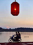Laos, Vientiane. The Lampions of Kong View restaurant at the banks of the Mekong at sunset.