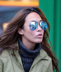 TV presenter Myleene Klass wearing a pair of mirror tinted shades, green coat and brown knee high boots, picking up her daughters Hero and Ava from school. London, UK. 28/01/2013<br /> BYLINE MUST READ : GOTCHAIMAGES.COM<br /> <br /> Copyright by © Gotcha Images Ltd. All rights reserved.<br /> Usage of this image is conditional upon the acceptance <br /> of Gotcha Images Ltd, terms and conditions available at<br /> www.gotchaimages.com