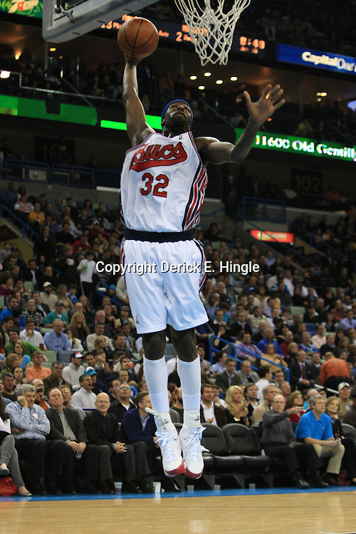 28 January 2009: New Orleans Hornets forward Julian Wright (32) attempts a dunk during a 94-81 win by the New Orleans Hornets over the Denver Nuggets at the New Orleans Arena in New Orleans, LA. The Hornets wore special throwback uniforms of the former ABA franchise the New Orleans Buccaneers for the game as they honored the Bucs franchise as a part of the NBA's Hardwood Classics series. .