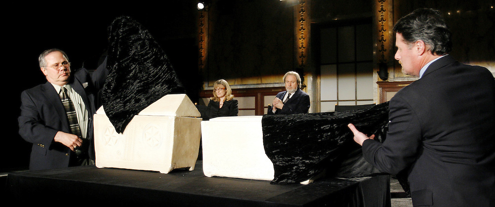 Two men unveil two limestone ossuaries (bone boxes) that filmmakers Simcha Jacobovici and James Cameron allege may have belonged to Mary Magdalene, on left, and Jesus of Nazareth, on right, during a press conference at the New York Public Library about the discovery of a tomb in Jerusalem that may have held the remains of Jesus and his family in New York, New York on Monday 26 February 2007. The assertion, based on archeology and statistical  findings, will be airing in a documentary on the Discovery Channel called 'The Lost Tomb Jesus'.