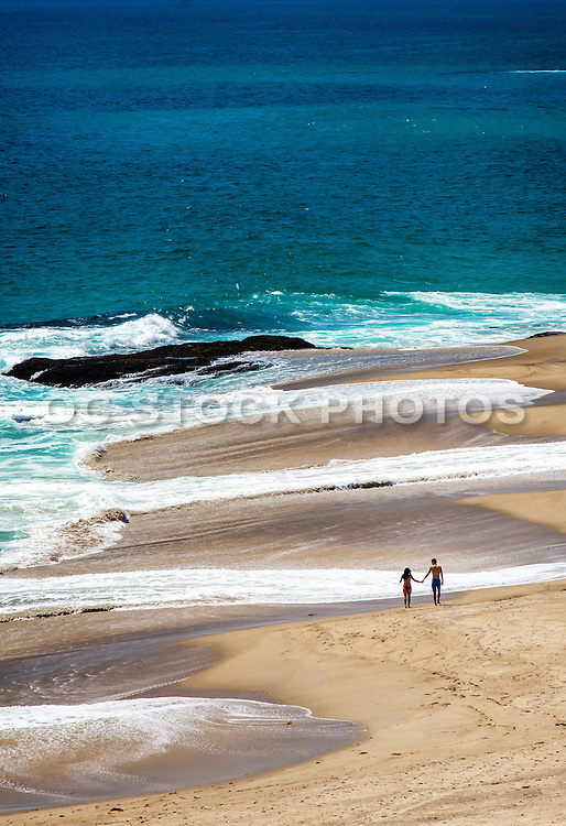 Young Couple Walking On The Beach In Laguna
