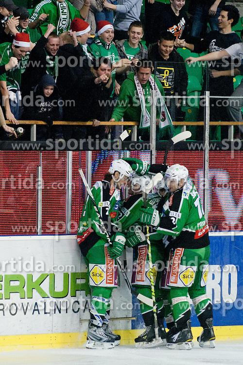 Team HDD Tilia Olimpija celebrate goal during ice-hockey match between HDD Tilia Olimpija and EHC LIWEST Linz in 35th Round of EBEL league, on December 30, 2011 at Hala Tivoli, Ljubljana, Slovenia. (Photo By Matic Klansek Velej / Sportida)