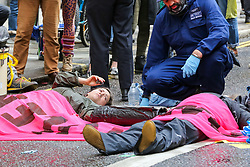 © Licensed to London News Pictures. 25/04/2019. London, UK. Environmental activists from Extinction Rebellion Movement Group glued themselves on Fleet Street in City of London as part of their ongoing action demanding decisive action from the UK Government on the environmental crisis. Photo credit: Dinendra Haria/LNP