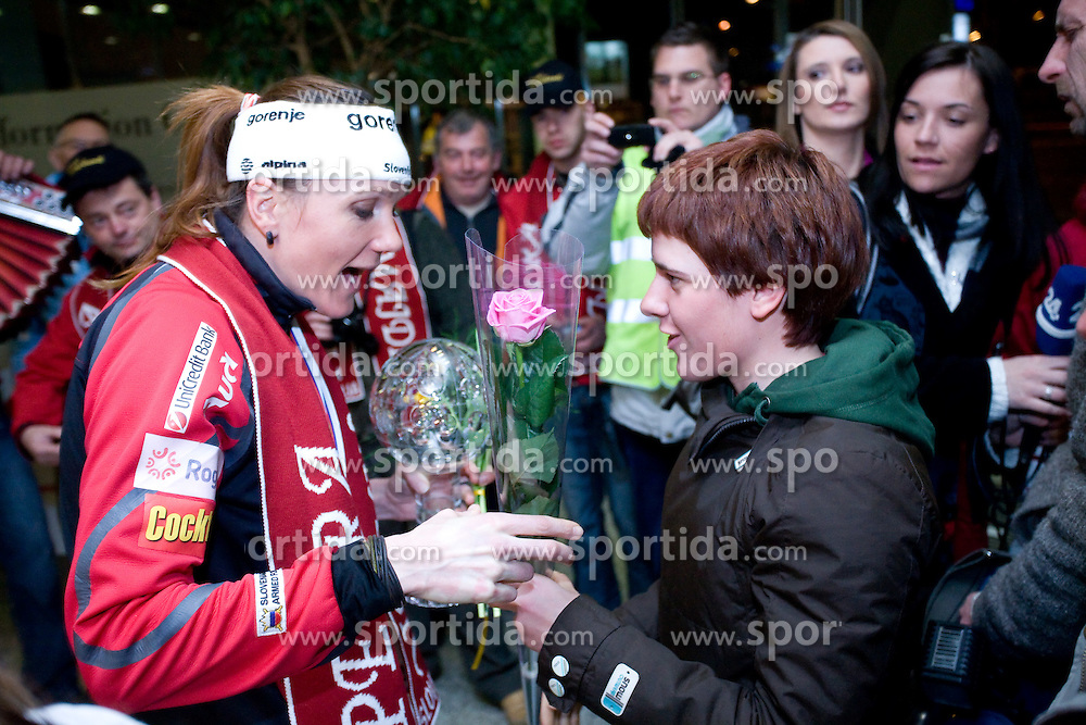 Slovenian athlete Petra Majdic celebrates with Barbara Jezersek when she arrived home with cristal globus at the end of the nordic season 2008/2009, on March 23, 2009, at airport Jozeta Pucnika, Brnik, Slovenia. (Photo by Vid Ponikvar / Sportida)