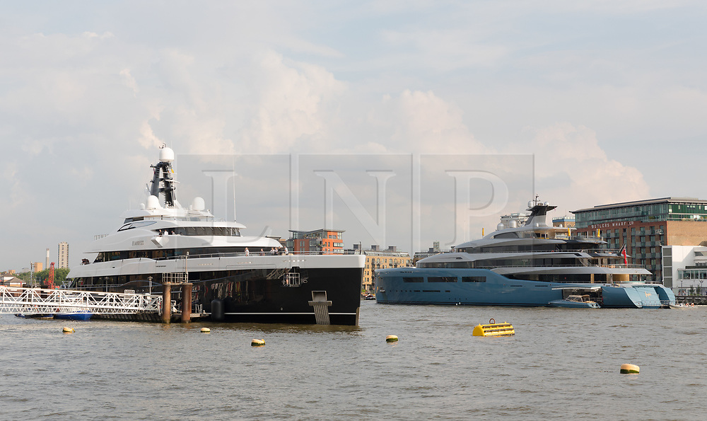 © Licensed to London News Pictures. 04/07/2018. London, UK.  The new 243 feet long superyacht, Elandess arrives in London for the first time ever on the River Thames and moors  at HMS President, the Royal Navy Reserve Unit and seen here this evening opposite the Aviva superyacht which arrived last week. Elandess was built at the Abeking and Rasmussen shipyard in Germany, launched in May 2018 and has just completed sea trials ahead of its London visit. Elandess has an axe-bow, dark hull and low-slung superstructure. There are a variety of entertaining communal spaces, from the 8 x 2.5-metre superyacht swimming pool located on the massive sun deck to the Nemo Lounge with portholes below the waterline and an observation lounge on the upper deck. Guest accommodation includes six staterooms, including the master suite which is placed forward on the main deck with an observation lounge directly above on the upper deck.  Photo credit: Vickie Flores/LNP
