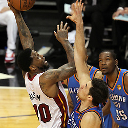 Jun 21, 2012; Miami, FL, USA; Miami Heat power forward Udonis Haslem (40) shoots against Oklahoma City Thunder power forward Nick Collison (4) during the second quarter in game five in the 2012 NBA Finals at the American Airlines Arena. Mandatory Credit: Derick E. Hingle-US PRESSWIRE