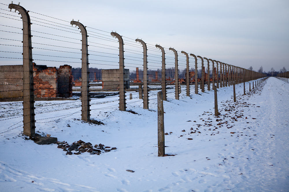 A barbed wire fence is surrounding the men's camp also called sector BIId at the Auschwitz Birkenau site. It is estimated that between 1.1 and 1.5 million Jews, Poles, Roma and others were killed in Auschwitz during the Holocaust in between 1940-1945.