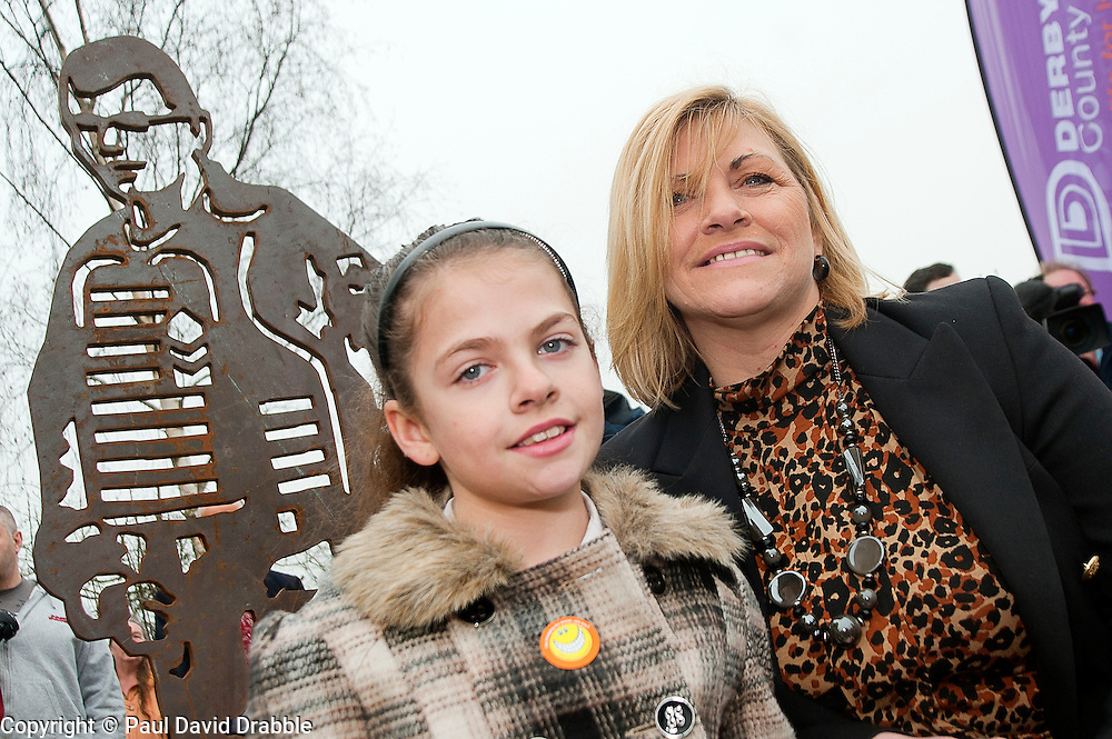 Cpl Liam Rileys mum Cheryl and his sister Olivia paid tribute to Liam who was killed in killed in Helmand province Afghanistan on 1 February 2010 while serving with 3rd Battalion The Yorkshire Regiment (3 YORKS) this morning during the unveiling of The Portrait Bench at Killamarsh. Statues standing along side Liam are Sheffield Boxer and former British, Commonwealth, European and World titles holder Clinton Woods and Local Community volunteer worker Colin Savage..http://www.pauldaviddrabble.co.uk.14 March 2012 .Image © Paul David Drabble