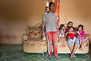 Purnomo (40 years) with his wife Elia (33 years) and his children  Pepi (5 years), Eric (4 month) and Bening (7 years). They live in a house with sight on their own illegal tin mine, the only source of income for this family in Mapur.<br /> Bangka Island (Indonesia) is devastated by illegal tin mines. The demand for tin has increased due to its use in smart phones and tablets.<br /> <br /> <br /> <br /> Purnomo (40 ans) avec sa femme Elia (33 ans) et ses enfants Pepi (5 ans), Eric (4 mois) et Bening (7 ans). Habitent une maison dans une mine. <br /> Mine d'étain illégale et familiale dans jardin à <br /> Mapur. <br /> L'île de Bangka (Indonésie) est dévastée par des mines d'étain sauvages. la demande de l'étain a explosé à cause de son utilisation dans les smartphones et tablettes