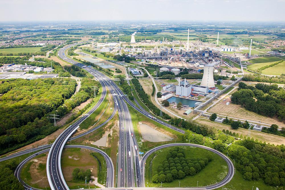 Nederland, Limburg, Gemeente Sittard-Geleen, 27-05-2013;  verkeersknooppunt Zaarderheiken, klaverturbine A76 en A2<br /> DSM en Chemelot in de achtergrond.<br /> Junction Kerensheide, motorway A2 en A73. <br /> luchtfoto (toeslag op standaardtarieven);<br /> aerial photo (additional fee required);<br /> copyright foto/photo Siebe Swart.