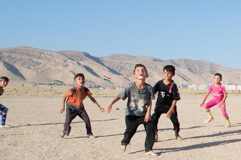 Children playing football in the camp for Yazidi IDPs near Dohuk in Shariya, Iraq, August 19, 2015