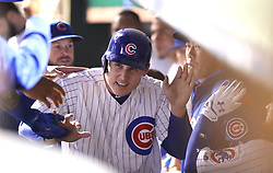 September 14, 2017 - Chicago, IL, USA - The Chicago Cubs' Anthony Rizzo is congratulated in the dugout after scoring on a sacrifice fly by teammate Ian Happ in the fourth inning against the New York Mets at Wrigley Field in Chicago on Thursday, Sept. 14, 2017. (Credit Image: © Chris Sweda/TNS via ZUMA Wire)