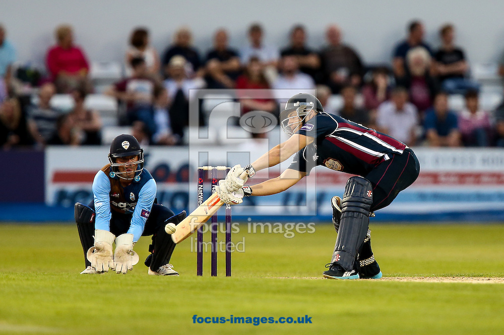 Adam Rossington of Northants Steelbacks (right)  reaches for the ball during the Natwest T20 Blast match at the County Ground, Northampton<br /> Picture by Andy Kearns/Focus Images Ltd 0781 864 4264<br /> 11/07/2014