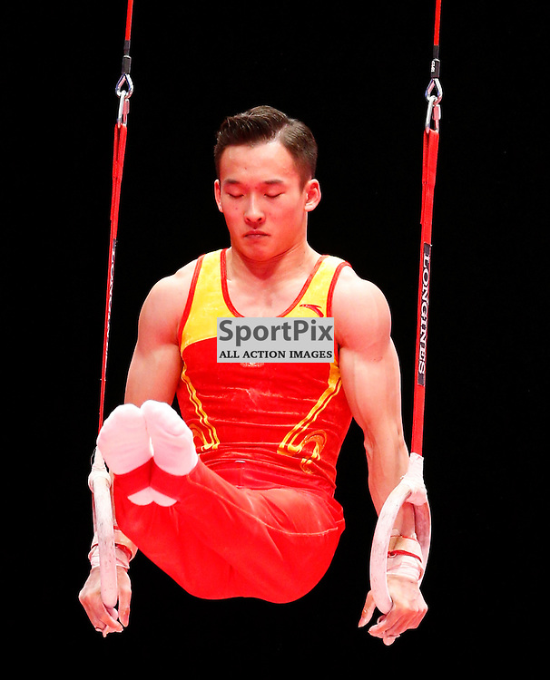 2015 Artistic Gymnastics World Championships being held in Glasgow from 23rd October to 1st November 2015.....Ruoteng Xiao (Peoples Republic of China) competing in the Still Rings competition..(c) STEPHEN LAWSON | SportPix.org.uk