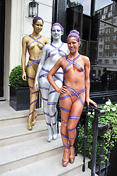 Painted models at the launch of Hideaways House at Morton's Club, Berkeley Square, London on 25th July 2012.
