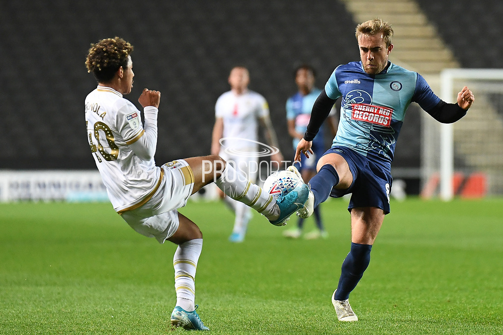 Milton Keynes Dons defender Matthew Sorinola (40) battles for possession  with Wycombe Wanderers midfielder Alex Pattison (8) during the EFL Trophy match between Milton Keynes Dons and Wycombe Wanderers at stadium:mk, Milton Keynes, England on 12 November 2019.