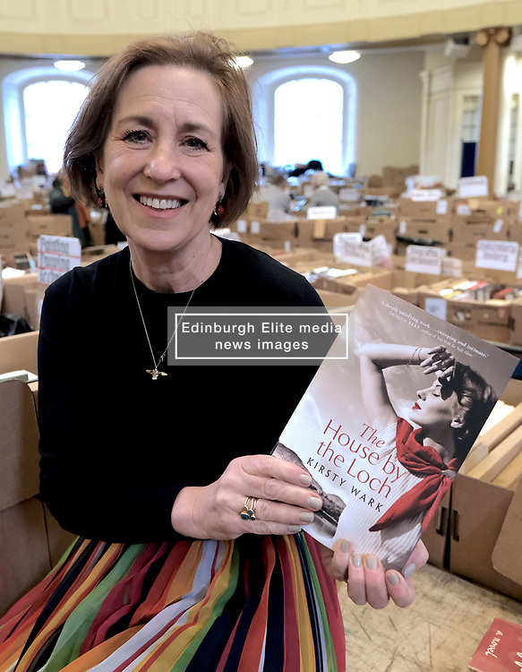 """Journalist Kirsty Wark is photographed ahead of the Christian Aid week George Street book sale. Items on sale include first editions of George Orwell's 1984 and Animal Farm, a second edition of Walter Scott's Rob Roy and a signed first edition limited edition copy of TS Elliott's Dante. The sale will take place on Saturday. St Andrew's and St George's West Church, George Street, Edinburgh<br /> <br /> Pictured: Kirsty Wark with her new book due for release in June - """"The House by the Loch""""<br /> <br /> Alex Todd 