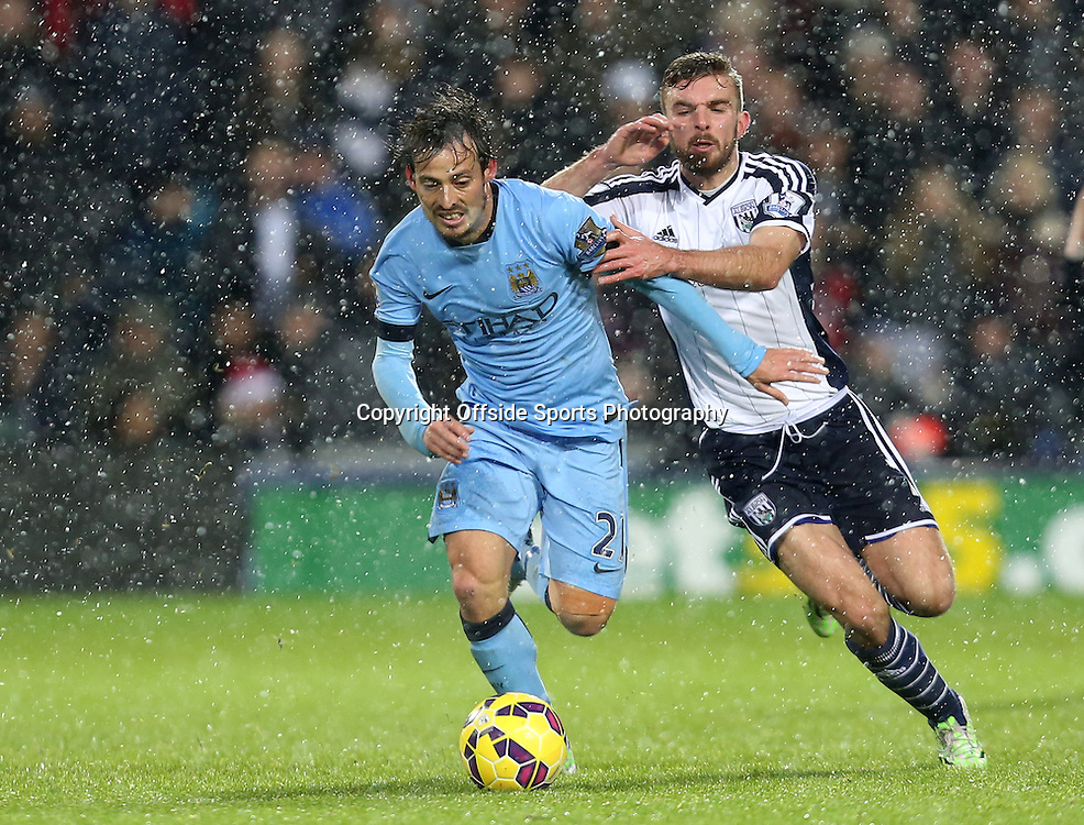 26th December 2014 - Barclays Premier League - West Bromwich Albion v Manchester City - David Silva of Manchester City battles with James Morrison of West Bromwich Albion - Photo: Paul Roberts / Offside.