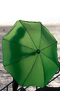 Man with green umbrella silhouette