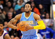 Nov. 12, 2012; Phoenix, AZ, USA; Denver Nuggets guard Andre Iguoldala (9) makes a pass the ball against the Phoenix Suns at US Airways Center. The Suns defeated the Nuggets 110-100. Mandatory Credit: Jennifer Stewart-USA TODAY Sports