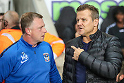 Coventry City Manager Mark Robins  and Forest Green Rovers manager, Mark Cooper during the EFL Trophy match between Coventry City and Forest Green Rovers at the Ricoh Arena, Coventry, England on 9 October 2018.