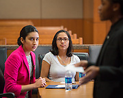 Milby High School students Jaqueline Laurenzana, left, and Shantelle Martinez, right, participate in a mock trail at the Harris County Civil Courthouse, July 30, 2014.