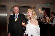 RICHARD BRIGGS; BASIA BRIGGS, Book launch party for the paperback of Nicky Haslam's book 'Sheer Opulence', at The Westbury Hotel. London. 21 April 2010