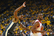 April 30, 2019; Oakland, CA, USA; Houston Rockets guard Chris Paul (3) dribbles the basketball against Golden State Warriors forward Alfonzo McKinnie (28) during the first quarter in game two of the second round of the 2019 NBA Playoffs at Oracle Arena.