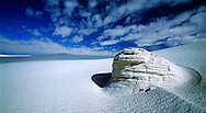 A clearing in the clouds allows for an ancient yardang to stand out in the middle of White Sands National Monument