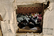 Schoolboys of Guan Shan at naptime in their makeshift dorm: a room rented to a local farmer.