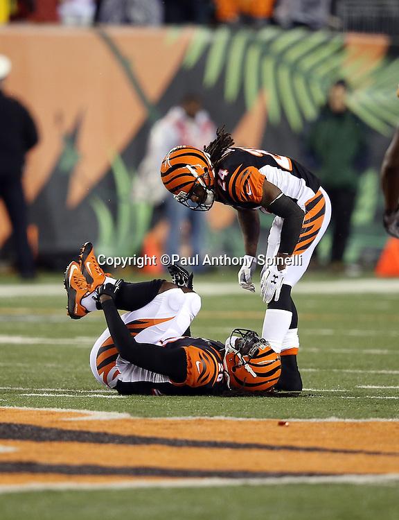 Cincinnati Bengals free safety Reggie Nelson (20) lies on the turf holding his injured ankle after a second quarter sack on Pittsburgh Steelers quarterback Ben Roethlisberger (7) for a loss of 10 yards during the NFL AFC Wild Card playoff football game against the Pittsburgh Steelers on Saturday, Jan. 9, 2016 in Cincinnati. The Steelers won the game 18-16. (©Paul Anthony Spinelli)