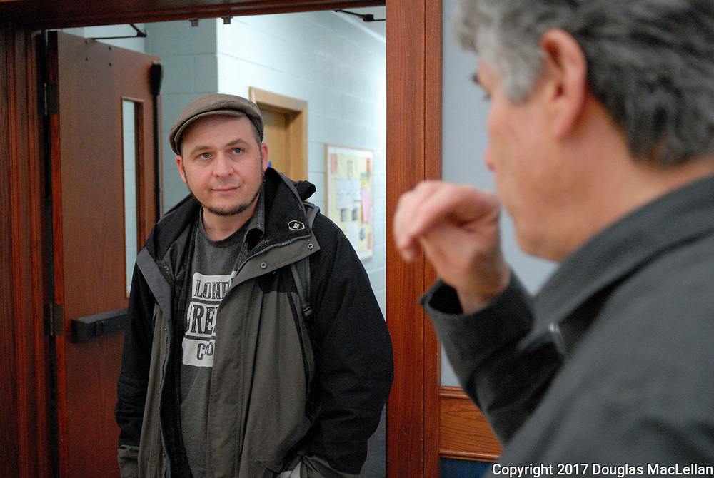 "CANADA, Windsor. May 2017. ""Building a Co-operative Culture in Windsor"", an all day workshop at All Saints' Church. ""Building"" is part of MayWorks Windsor 2017 programming. Jeff Pastorius, a workshop presenter speaks with Paul Chislett, the workshop organiser at the end of the event."