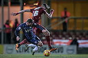 Noel Hunt (Southend United) slides in to win the ball from Reece Burke (Bradford City) during the Sky Bet League 1 match between Bradford City and Southend United at the Coral Windows Stadium, Bradford, England on 16 February 2016. Photo by Mark P Doherty.