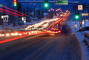 Rush hour traffic moves along Tudor Road in Anchorage, Alaska.