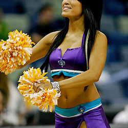 Oct 10, 2009; New Orleans, LA, USA;  A New Orleans Hornets Honeybees cheerleader performs during a break in the action during a preseason game against the Oklahoma City Thunder at the New Orleans Arena. The Hornets defeated the Thunder 88-79. Mandatory Credit: Derick E. Hingle-US PRESSWIRE