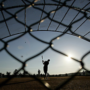 Irvington, NY / 2008 - The Famous Famiglia softball team takes batting practice at Scenic Hudson Park at Irvington Park in Irvington August 19. ( Mike Roy / The Journal News )