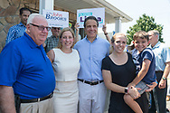 Massapequa, New York, USA. August 5, 2018. L-R, NY Senator JOHN BROOKS; LIUBA GRECHEN SHIRLEY, Congressional candidate for NY 2nd District; and Governor ANDREW CUOMO; pose with a supporter holding her young son during opening of joint campaign office for the 2 Long Islander candidates, aiming for a Democratic Blue Wave in November midterm elections.
