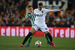 February 28, 2019 - Valencia, Valencia, Spain - Rodrigo Moreno of Valencia  and Andres Guardado of Betis battle for the ball during the Copa del Rey Semi Final match second leg between Valencia CF and Real Betis Balompie at Mestalla Stadium in Valencia, Spain on February 28, 2019. (Credit Image: © Jose Breton/NurPhoto via ZUMA Press)