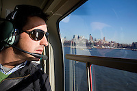 """31 October, 2008. New York, NY. Spanish matador David Fandila, 27, is here on a helicopter that takes him for a of tour Manhattan. David Fandila, better known in Spain and in the bullfighting world as """"El Fandi"""", came to New York for the premiere of  """"The Matador,"""" a documentary about him (released by City Lights). Him and his brother Juan Alvaro (his manager), 31, convinced by their friend Carlos Gil, will partecipate at the New York City Marathon on Sunday, November 2nd. El Fandi began as a matador in 2000 and is now one of the most skilled matadors in the world. <br /> <br /> ©2008 Gianni Cipriano for The New York Times<br /> cell. +1 646 465 2168 (USA)<br /> cell. +1 328 567 7923 (Italy)<br /> gianni@giannicipriano.com<br /> www.giannicipriano.com"""