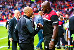 Rotherham United manager Paul Warne and Doncaster Rovers manager Darren Moore shake hands before kick off - Mandatory by-line: Ryan Crockett/JMP - 07/09/2019 - FOOTBALL - The Keepmoat Stadium - Doncaster, England - Doncaster Rovers v Rotherham United - Sky Bet League One