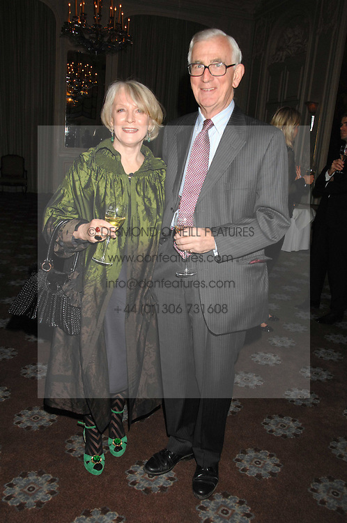 LUCIA VAN DER POST and her husband NEIL CRICHTON-MILLER at a dinner to celebrate the launch of the Dom Ruinart 1998 vinatage champage at Claridge's, Brook Street, London W1 on 23rd April 2008.<br />