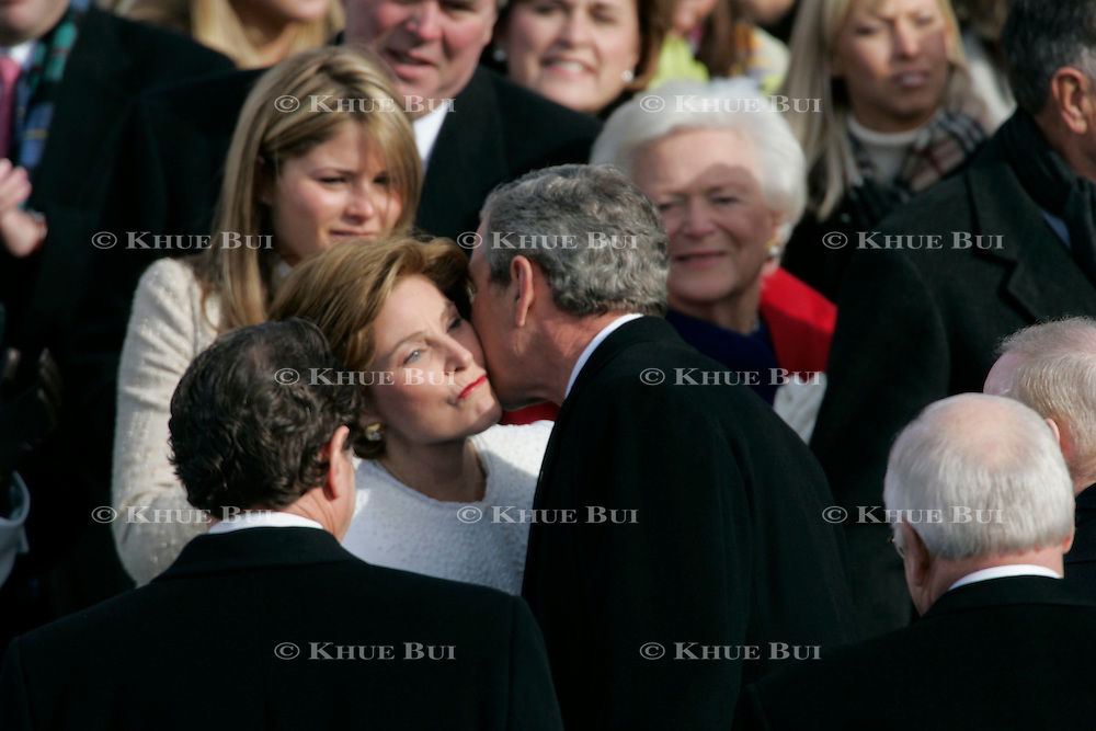 Presidential Inauguration 2005- GEORGE W. BUSH.Washington, DC.01/20/2005.West Front - US Capitol.President George Bush kisses First Lady Laura while daughter, Jenna and mother Barbara look on...Photo by Khue Bui..